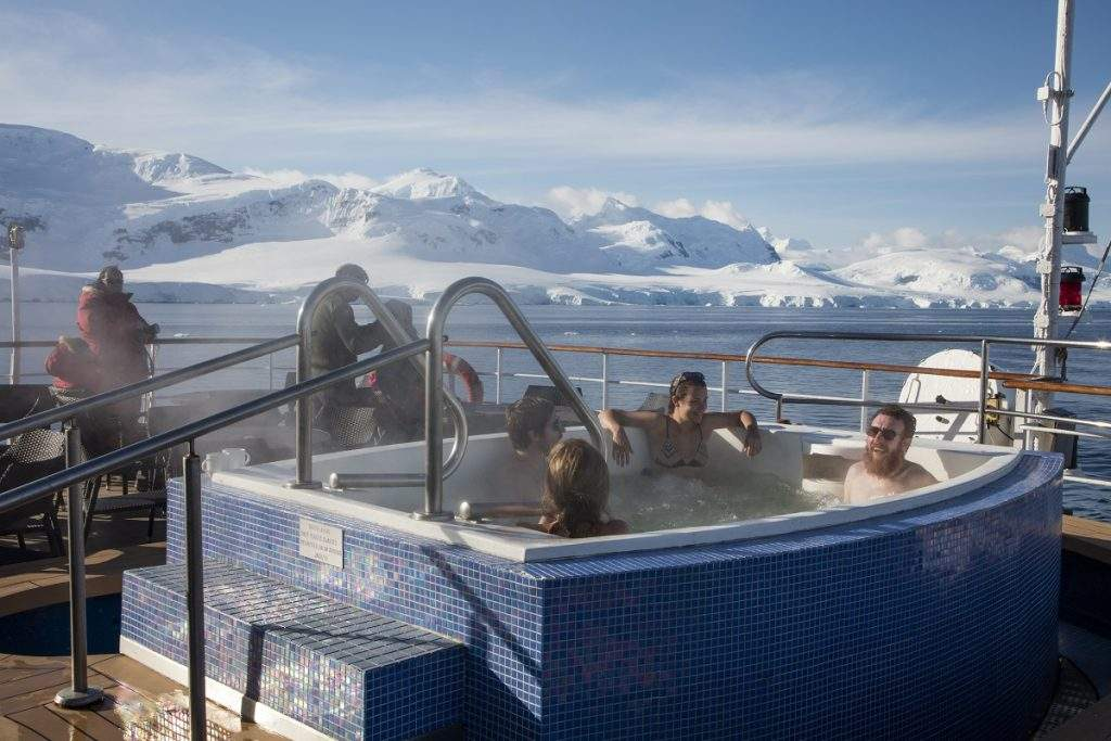 Passengers relax in jacuzzi aboard expedition cruise ship MV Sea Spirit (Poseidon Expeditions), Gerlache Strait, Graham Land, Antarctic Peninsula, Antarctica